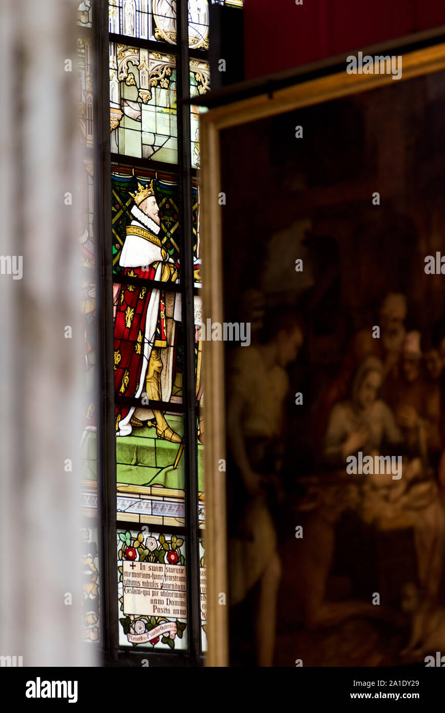 Detail of a stained glass king with a detail of a Peter Paul Reubens painting as seen in the Cathedral of Our Lady, Antwerp, Flanders, Belgium. Stock Photo