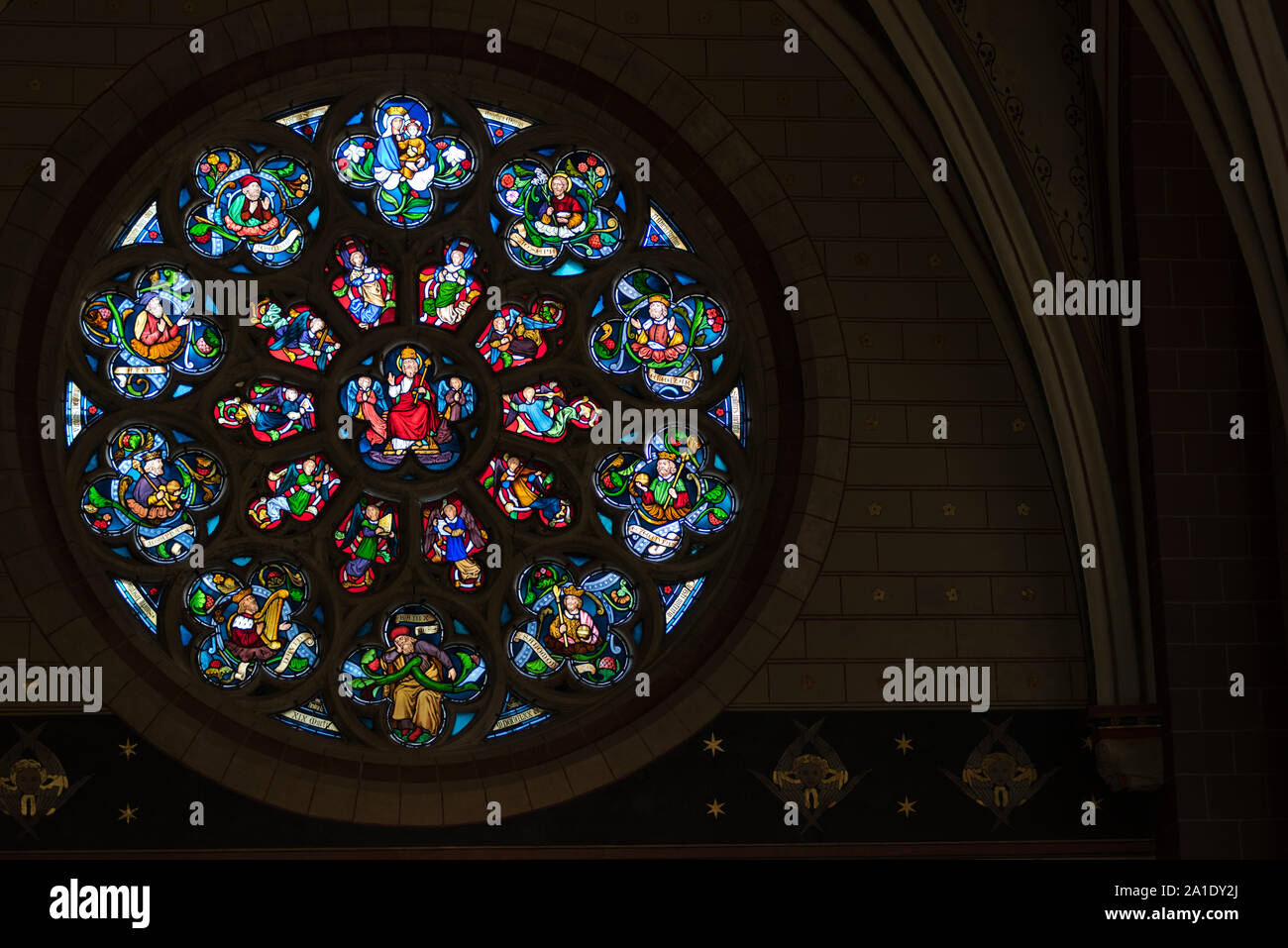 Rose window, stained glass window, as seen in the Cathedral of Our Lady, Antwerp, Flanders, Belgium. Stock Photo