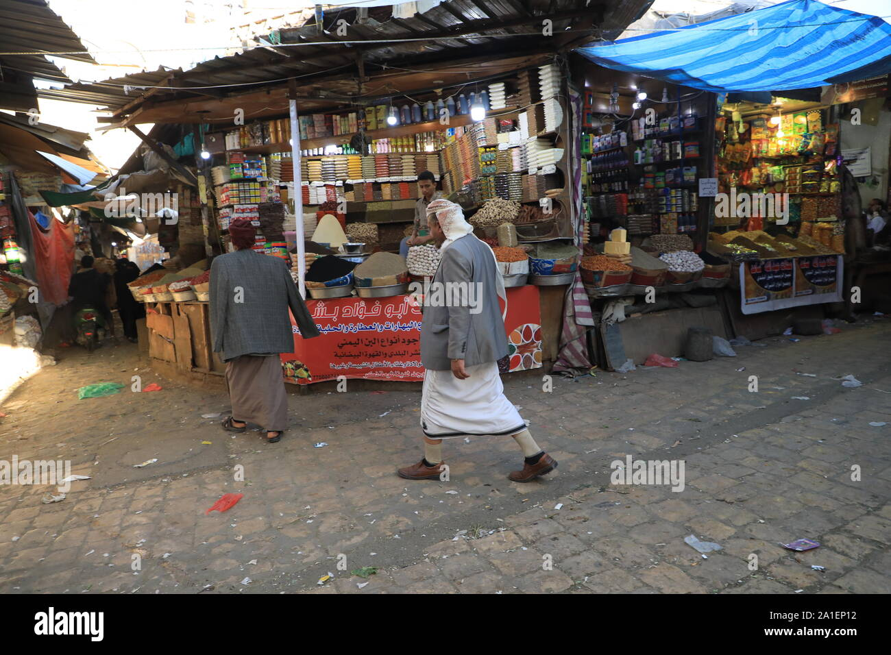 Yemenis shop at the market in the old city of Sana'a on Nov 13, 2018. Stock Photo