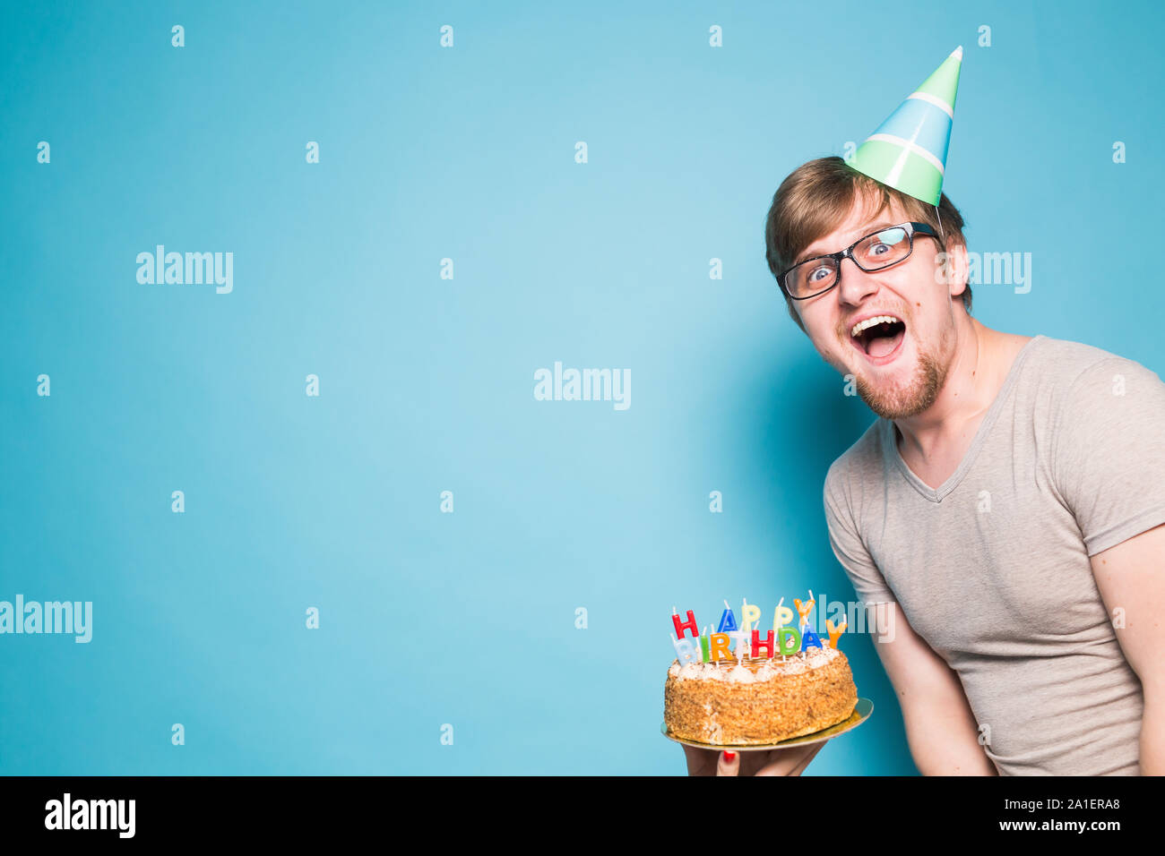 Strange Crazy Funny Positive Guy Hipster Holding A Happy Birthday Cake In Funny Birthday Cards Online Alyptdamsfinfo
