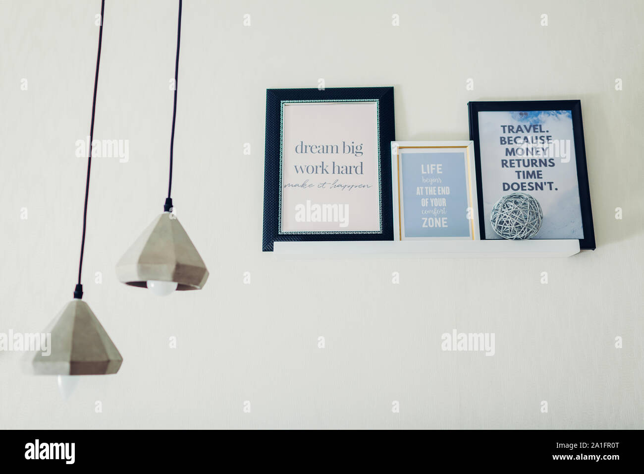 frames motivational and inspirational quotes put on shelf by