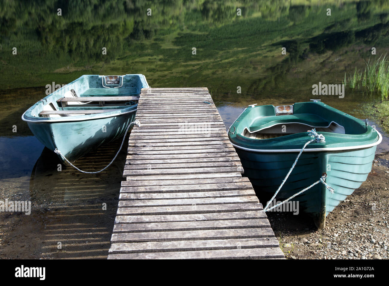 Two rowing boats moored at a Scottish highland loch Stock Photo