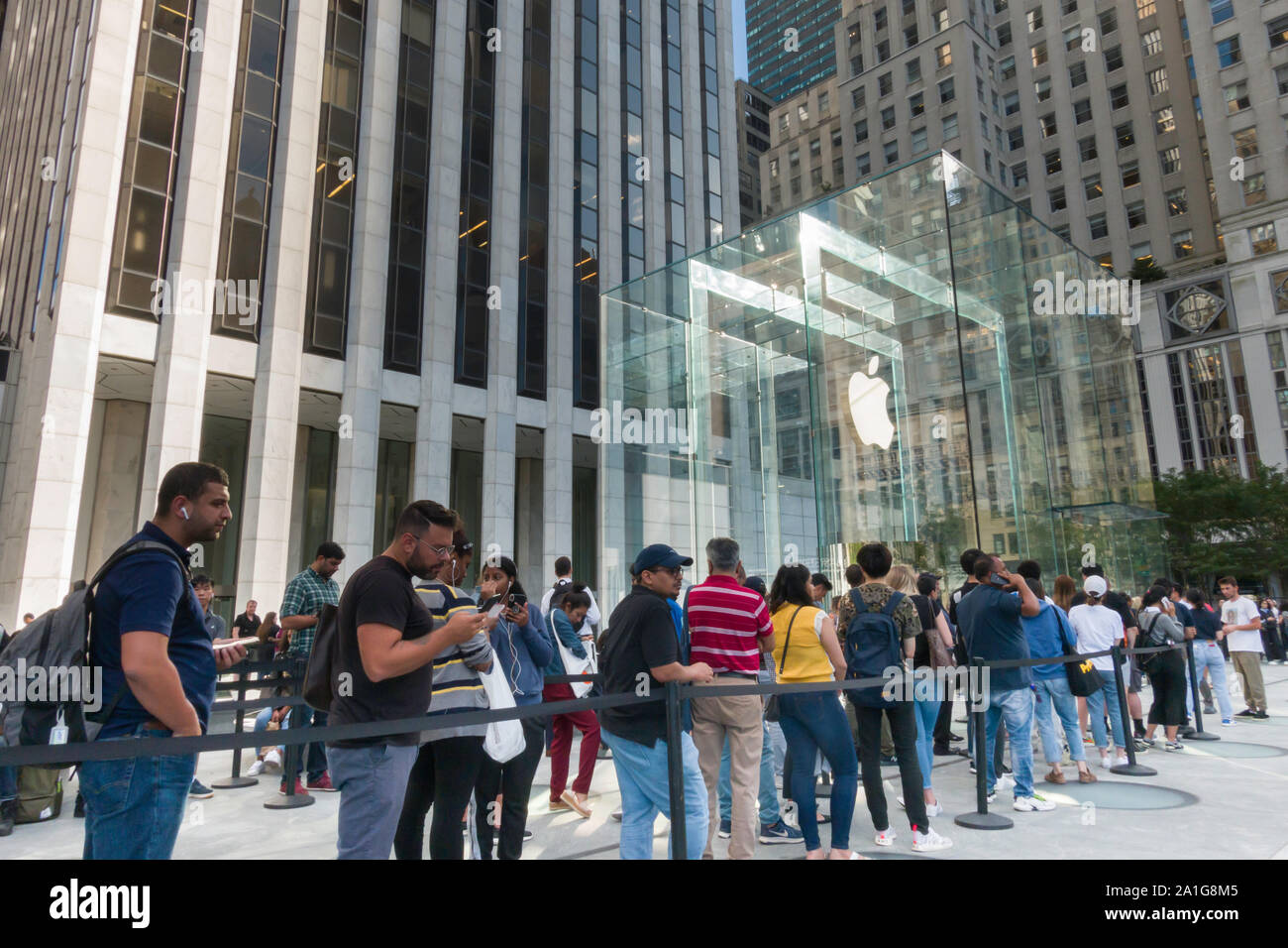 Apple Computer Store, Fifth  Avenue,  People in Line to purchase Latest iPhone Model, NYC Stock Photo
