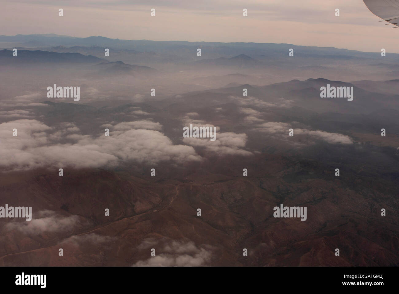 Landscape Aerial shot of mountain chain clouds and Mexican land approaching Tijuana Mexico Stock Photo