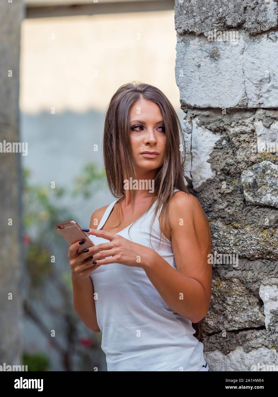 Cautious young woman Stock Photo