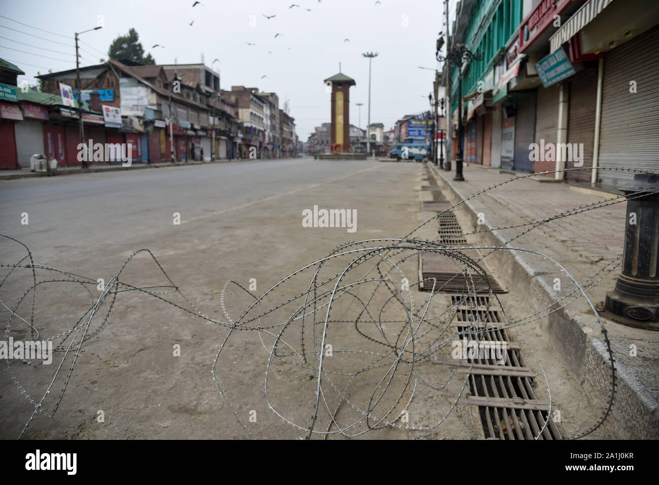 Deserted street with concertina wire during the restrictions in Srinagar.After the revocation of article 370 which gives the special status to Jammu & Kashmir, state authorities have imposed restrictions across Kashmir to prevent protests. Stock Photo