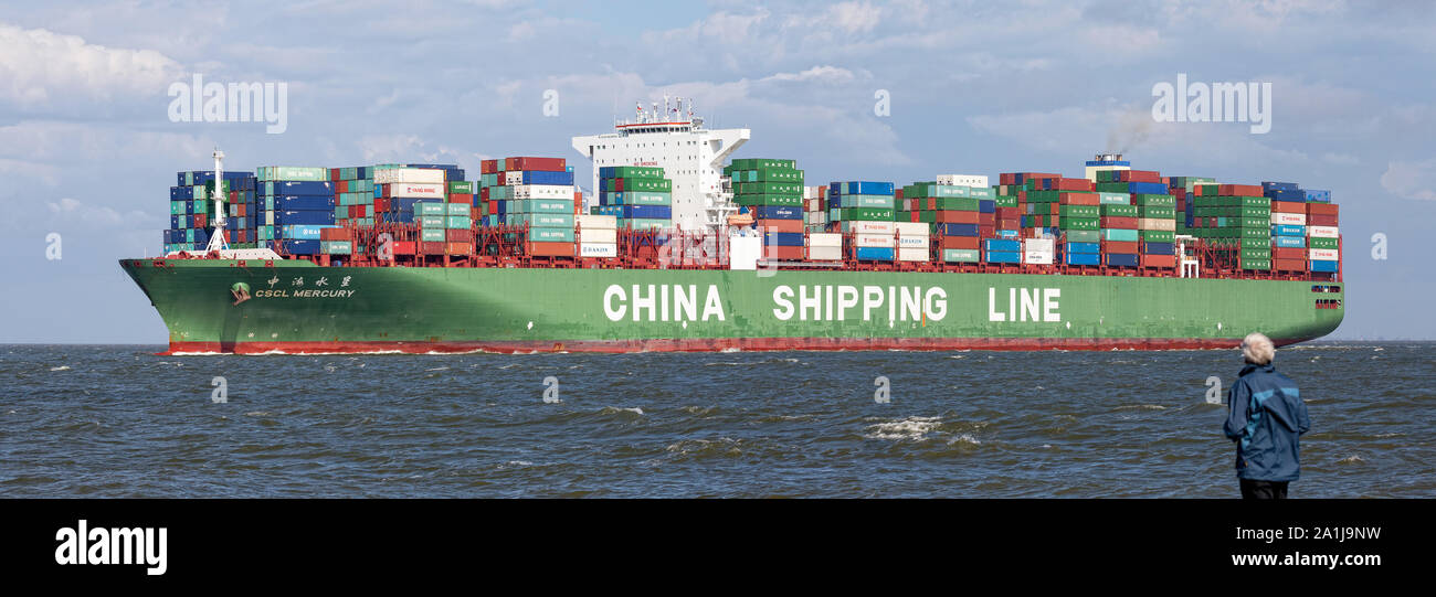 """Cuxhaven, GERMANY - June 14, 2014:  CSCL-Star-Typs Containership. Ultra Large Container Ship (ULCS) on its way to Bremerhaven. Passing by """"Alte Liebe"""" Stock Photo"""