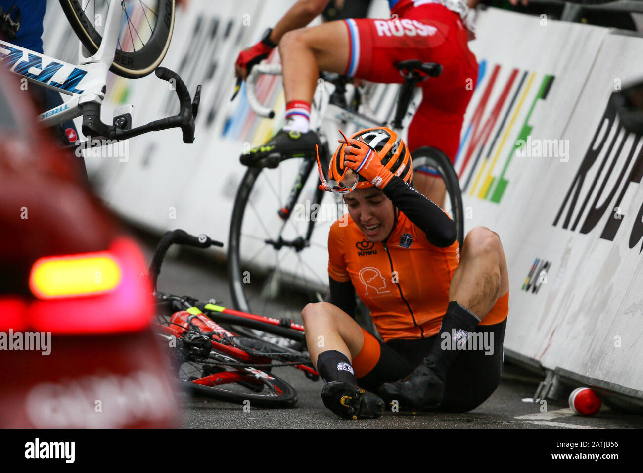 Harrogate, UK. 27th September 2019. Riders are down following a crash on the finish straight at the 2019 UCI Road World Championships Womens Junior Road Race. September 27, 2019 Credit Dan-Cooke/Alamy Live News Stock Photo