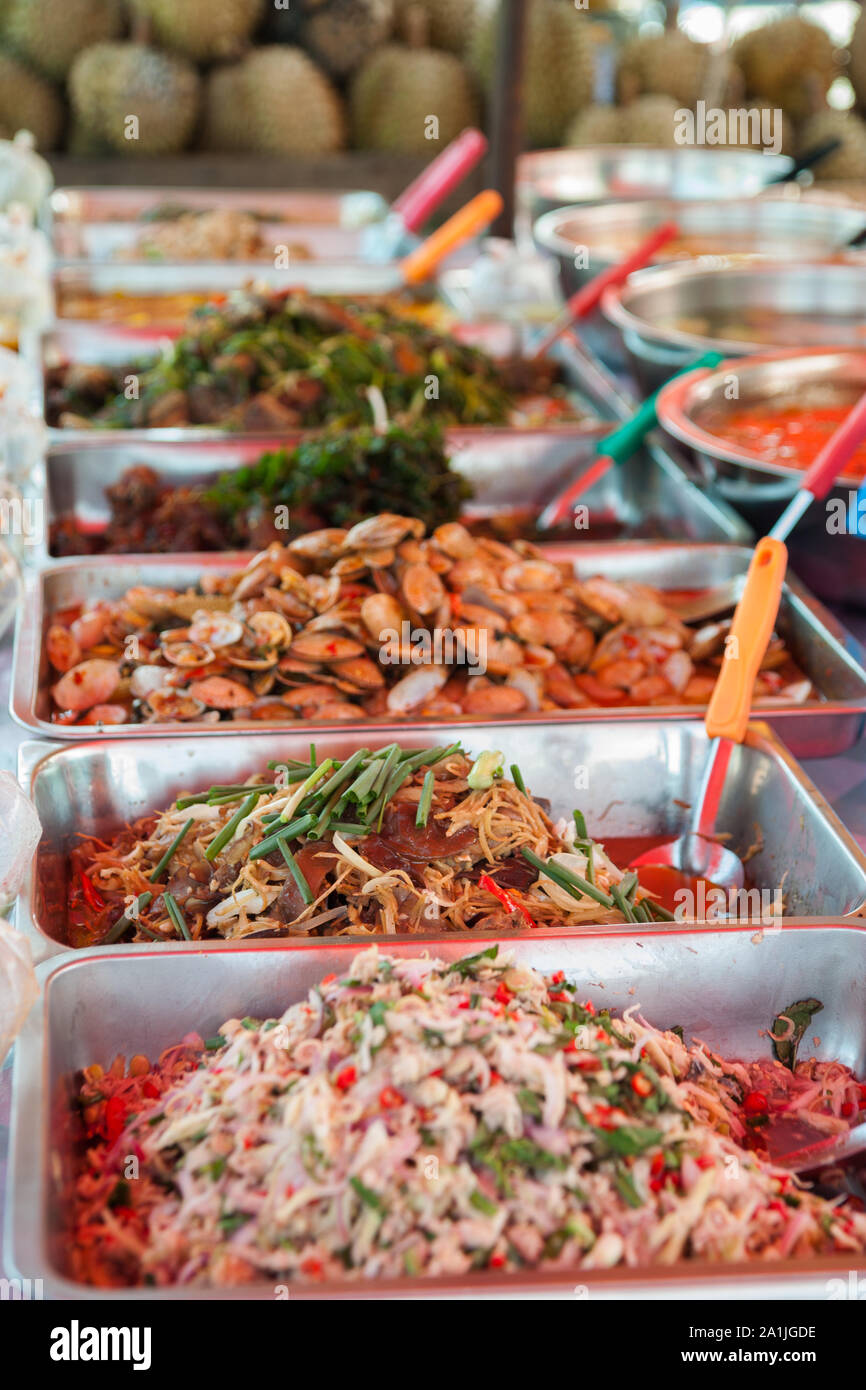 Freshly prepared dishes, ready to serve at the local market in Pakse, Laos Stock Photo