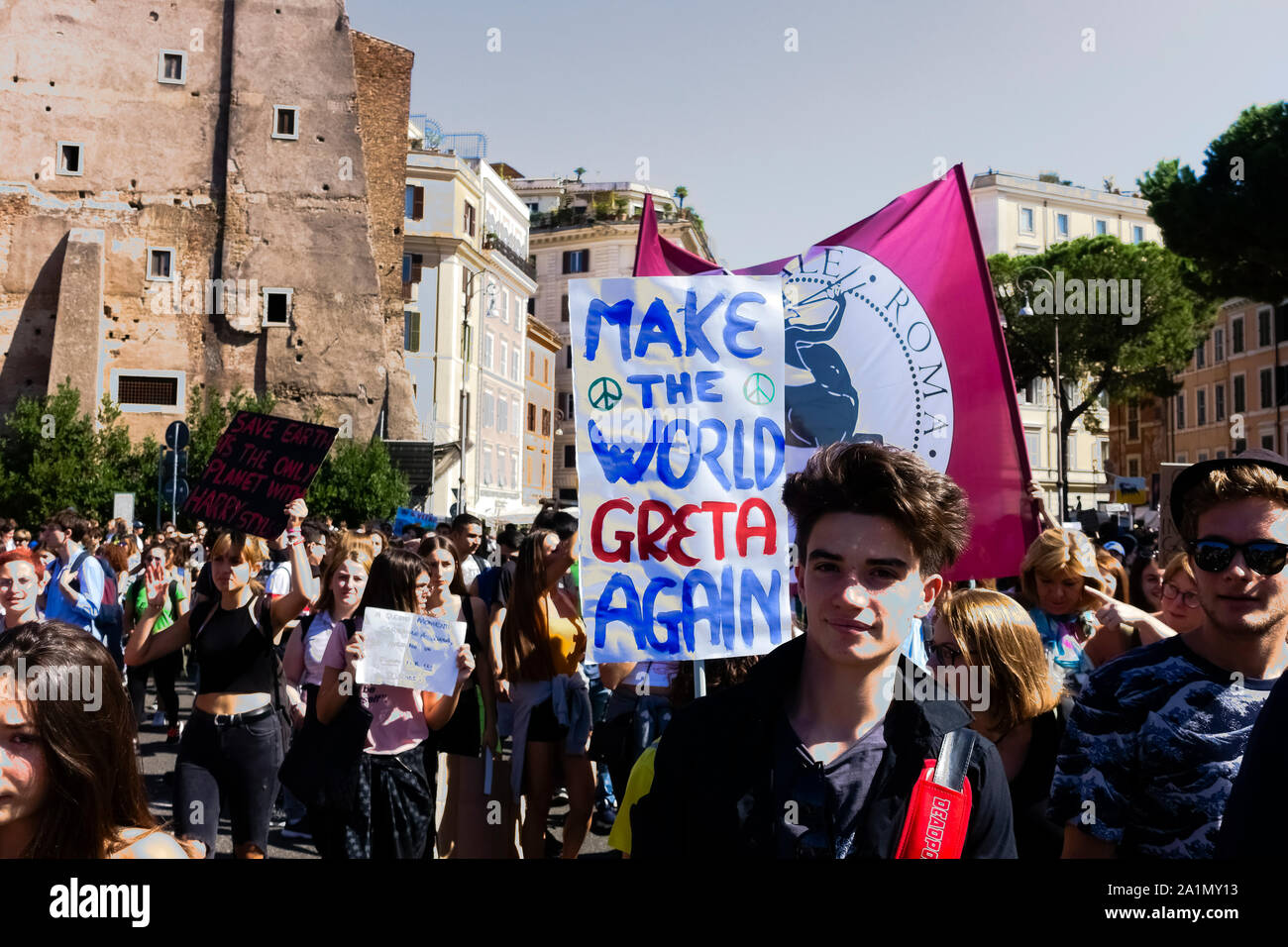 Fridays for future (FFF). Rome third global climate change strike for future. Young students demonstration march protest against climate change. System change not climate change. Students holding up banner sign, took to the streets to demonstrate against global climate change in central Rome, Italy, Europe, European Union. Every Friday skrike. 27th september 2019 Stock Photo