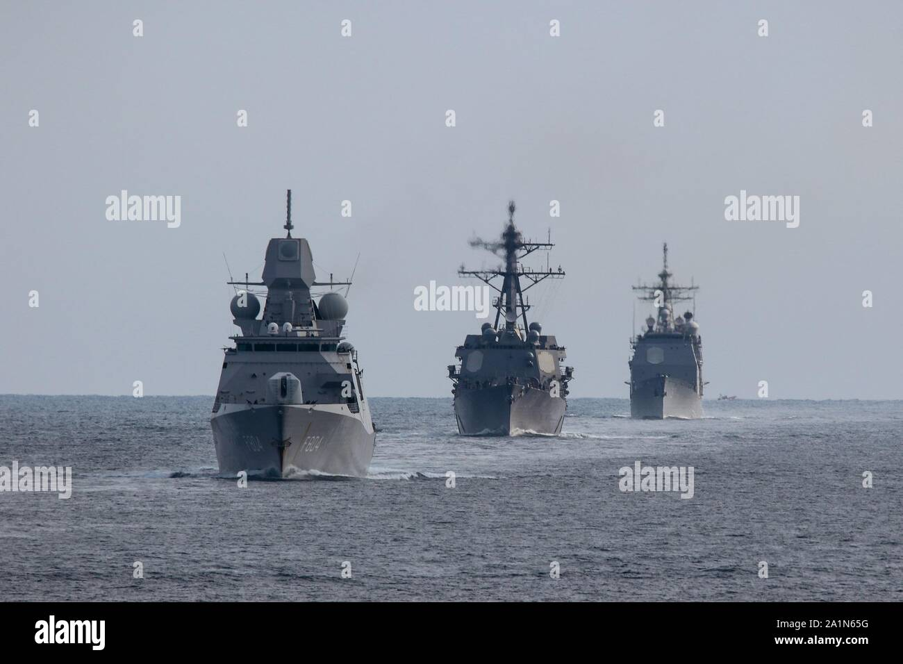 ATLANTIC OCEAN (Sept. 26, 2019) The Dutch navy frigate HNLMS De Ruyter (F804), left, Arleigh Burke-class guided missile destroyer USS Truxtun (DDG 103), center, and Ticonderoga-class guided missile cruiser USS Vella Gulf (CG 72) participate in a Group Sail exercise as part of Carrier Strike Group 10. CSG-10, also known as the Eisenhower CSG, is employed in a variety of roles, all of which involve gaining and maintaining sea control in an era of Great Power Competition. (U.S. Navy photo by LT Laura Radspinner/Released) Stock Photo