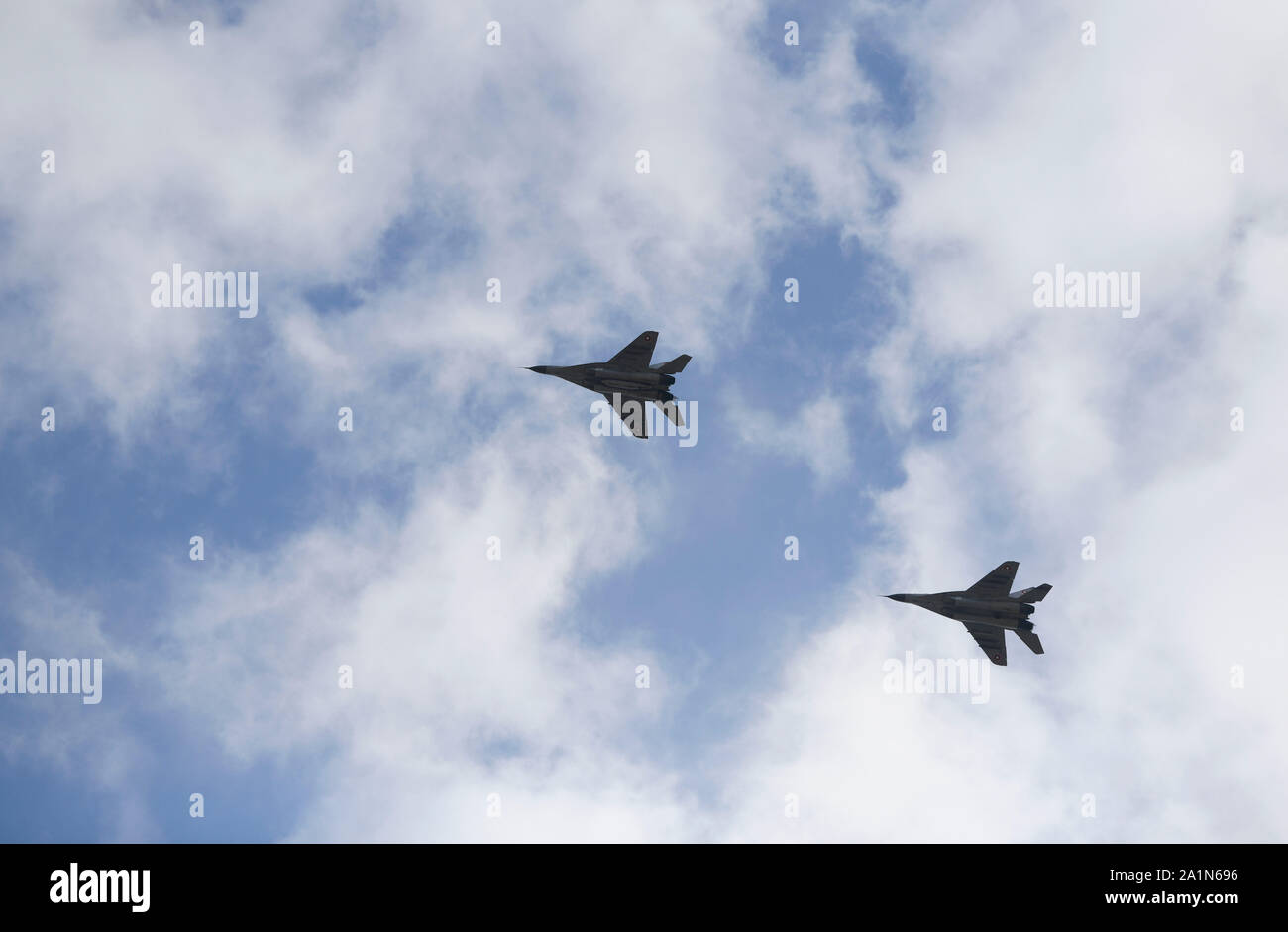 Bulgarian Air Force MiG-29s fly over Graf Ignatievo Air Base, Bulgaria, during exercise Rapid Buzzard Sept. 25, 2019. The 510th Fighter Squadron conducted air-to-air training with Bulgarian MiG-29s and air-to-surface training with Bulgarian Air Defense assets. (U.S. Air Force photo by Senior Airman Savannah L. Waters) Stock Photo