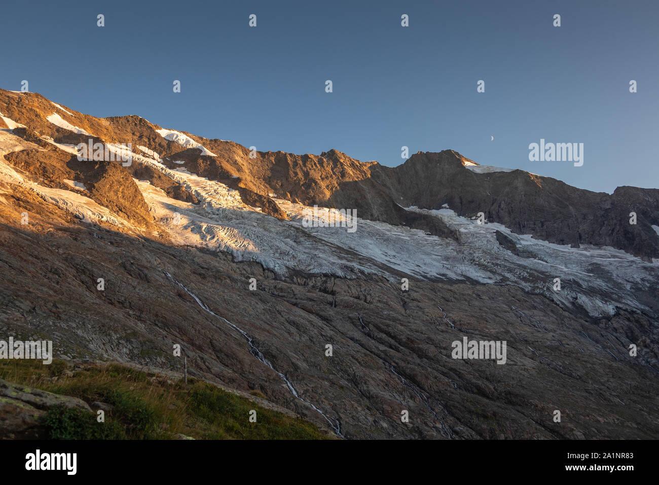 Krimmler Kees glacier. Seracs and crevasses. Sunset sunlight. Krimmler Achen valley. Hohe Tauern National Park. Austrian Alps. Stock Photo