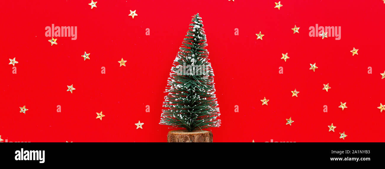 Top Christmas Toys 2020.Christmas Tree Toy And Golden Confetti On Red Background