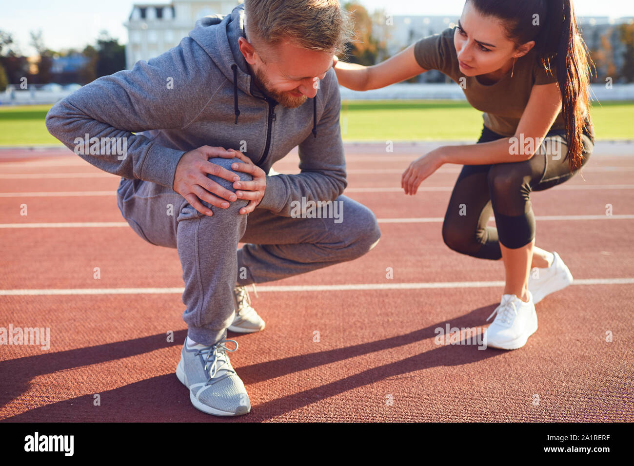 Knee injury in training. A male injured his leg during exercise. Stock Photo