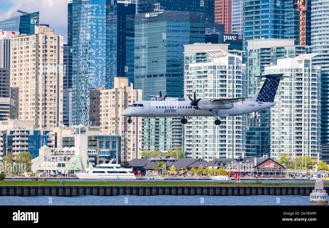 Porter Airlines Bombardier Q400 aircraft on its final approach to Bill Bishop Airport in downtown Toronto Ontario Canada. Stock Photo