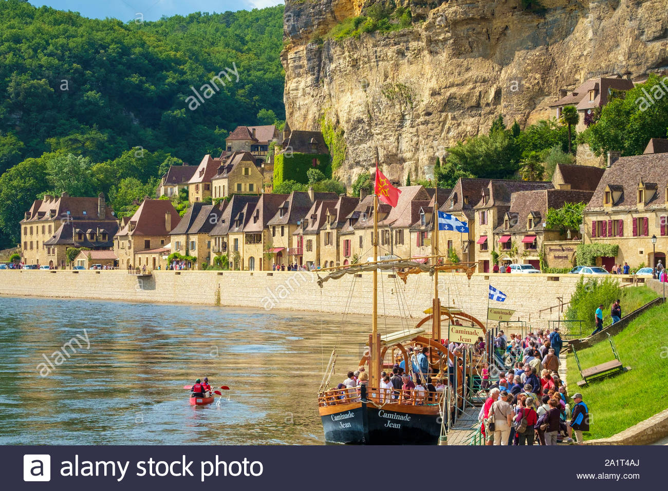 Tourist boarding a boat on Dordogne River, La Roque-Gageac, Dordogne Department, Aquitaine, France Stock Photo