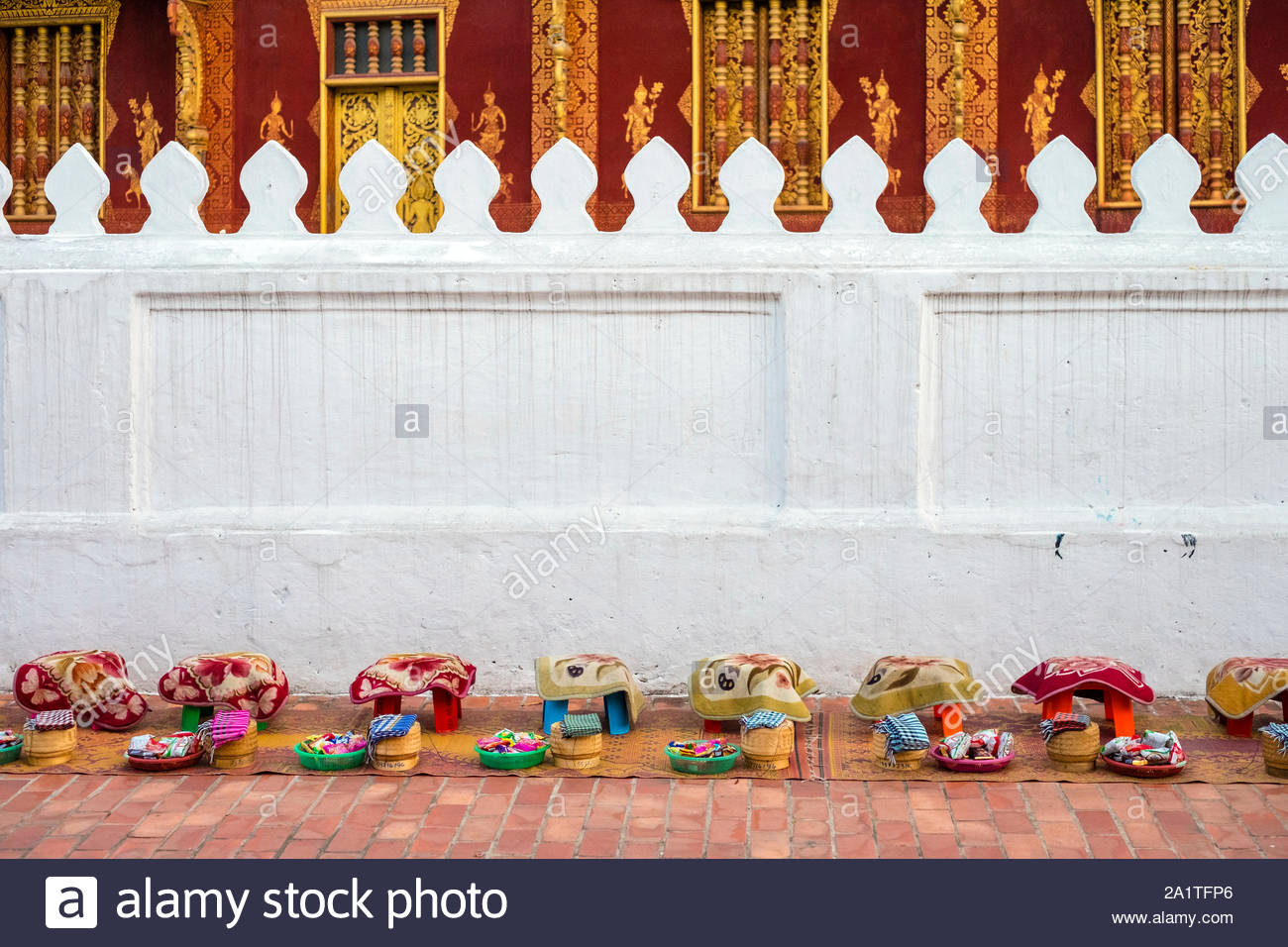 Almsgiving (Tak Bat) in front of Wat Sene Souk Haram temple, Luang Prabang, Louangphabang Province, Laos Stock Photo