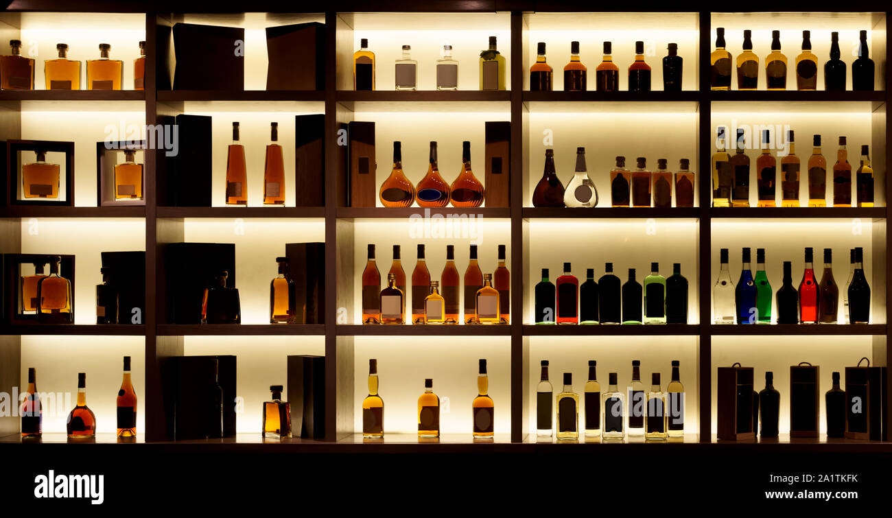 Various Alcohol Bottles In A Bar Back Light All Logos
