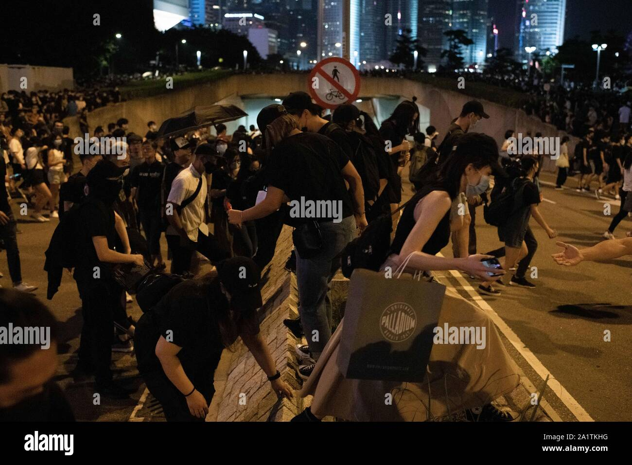 Hong Kong, China. 28th Sep, 2019. Protesters cross an avenue to attend the demonstrations in Admiralty.Demonstrations continue in Hong Kong in another night of protests during the commemoration of the 5th anniversary of the Umbrella Movement at Tamar Park. Credit: SOPA Images Limited/Alamy Live News Stock Photo