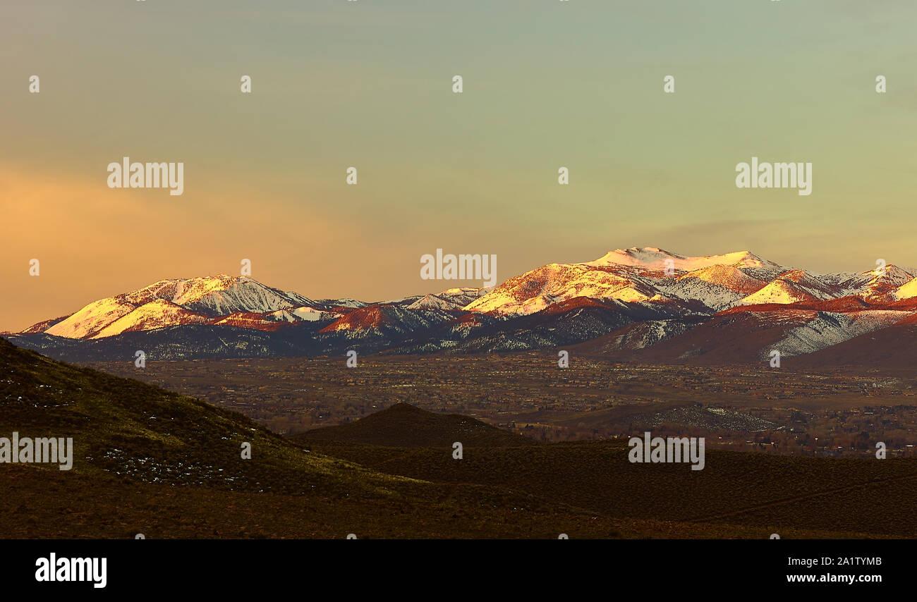 Sunrise in the snow capped Sierra Nevada mountains near Reno Nevada. Stock Photo
