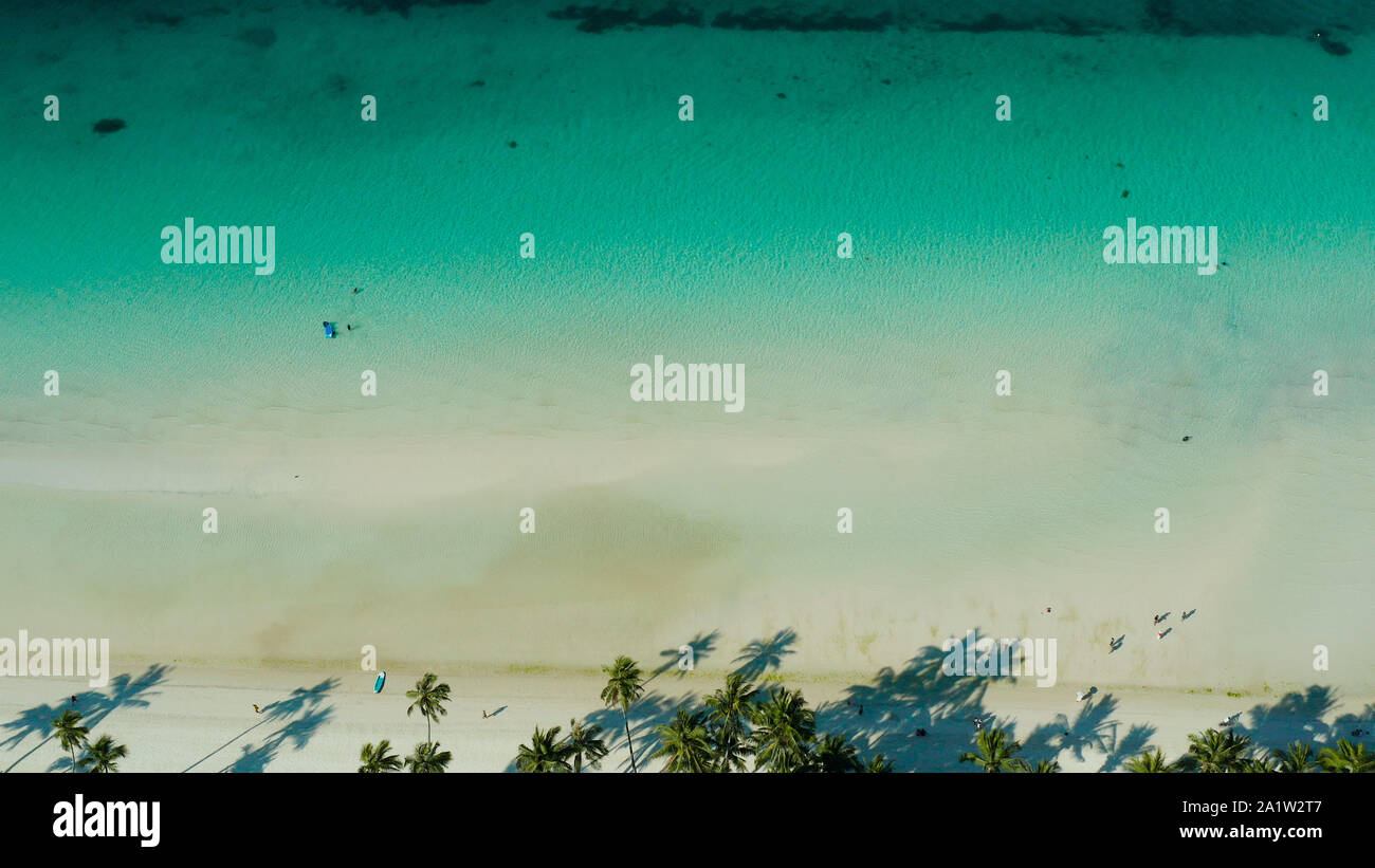 Tropical sandy beach with wave and turquoise water,copy space for text, aerial view. Ocean with waves and tropical beach. Summer and travel vacation concept Stock Photo