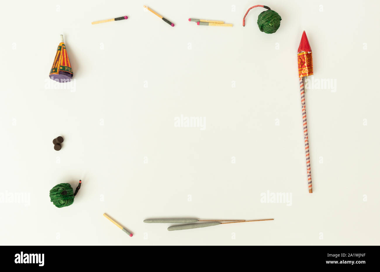 Flat lay of different types of Diwali Firecrackers arranged in frame for copy space on isolated background Stock Photo