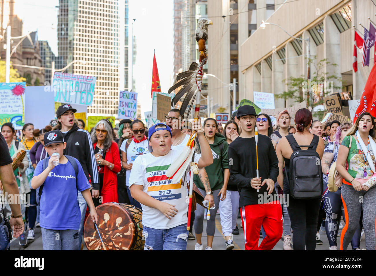 TORONTO, ONTARIO, CANADA - SEPTEMBER 27, 2019:  'Fridays for Future' climate change protest. Thousands of people march with signs. Stock Photo