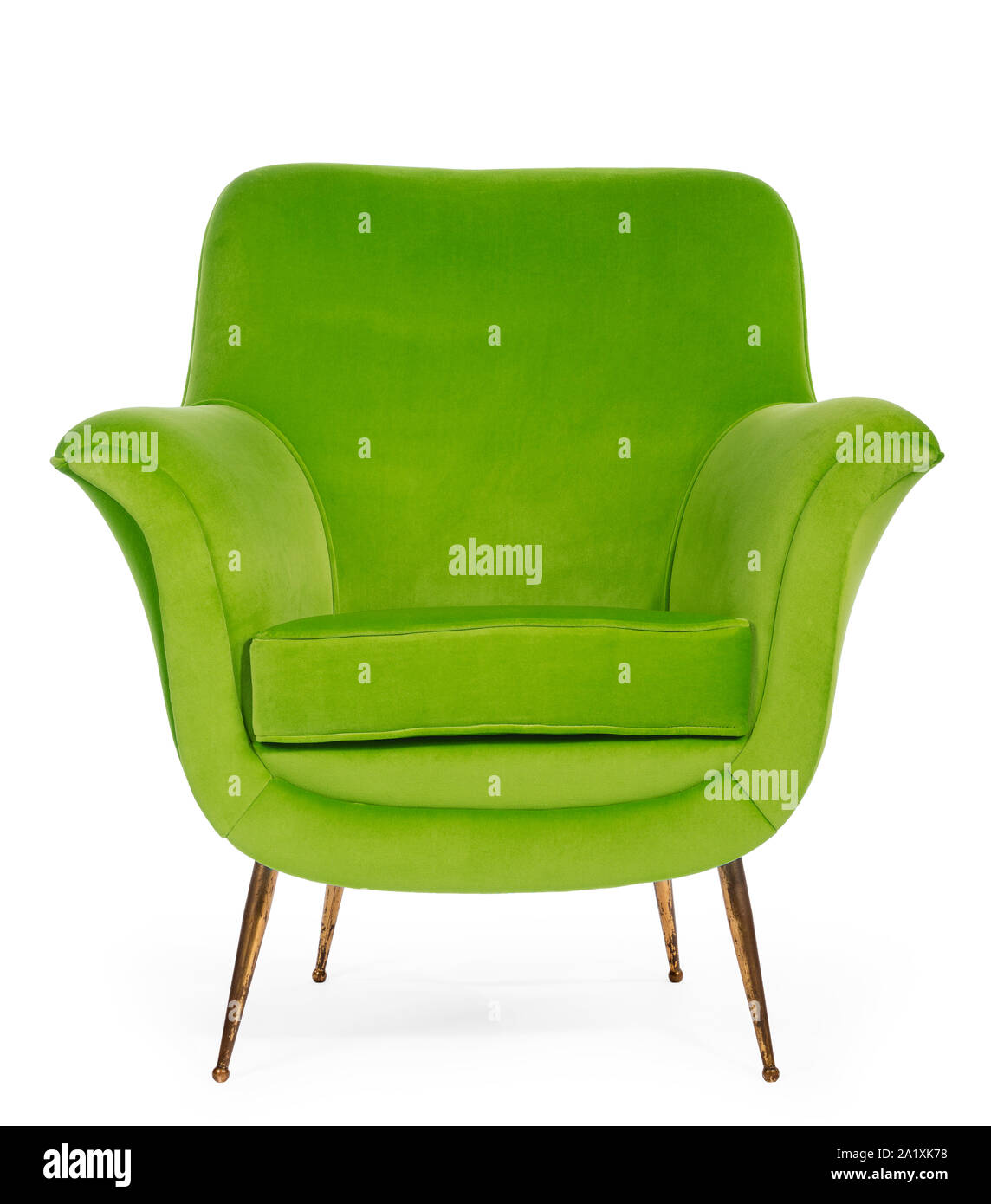Old antique sixties retro arm chair in lime green upholstery Stock