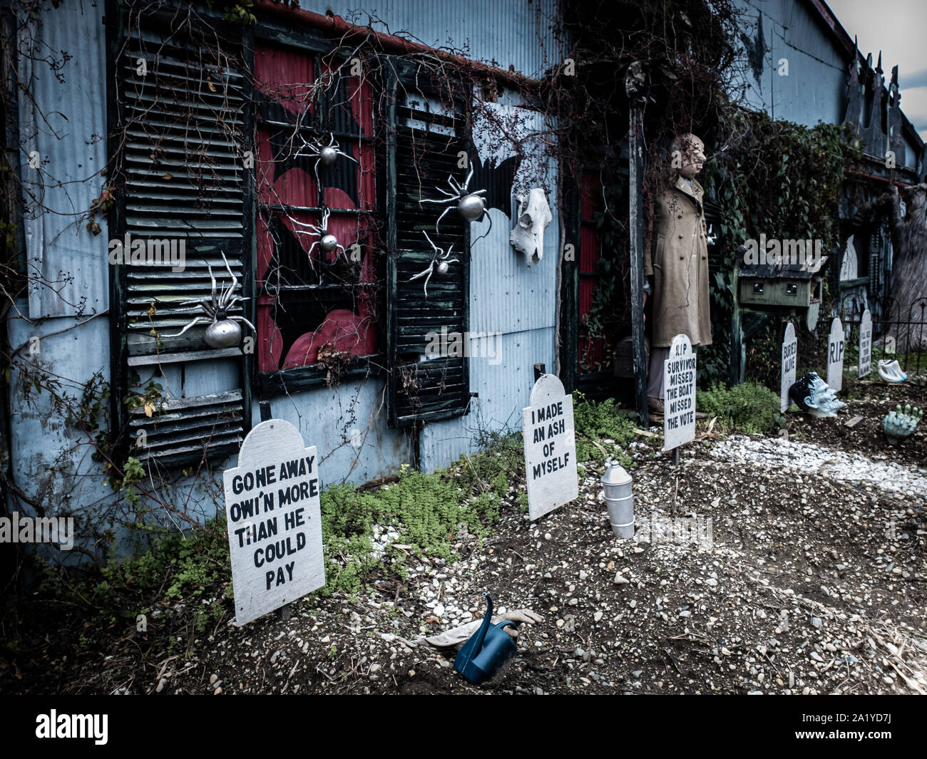 Funny Halloween decorations in front of a haunted house