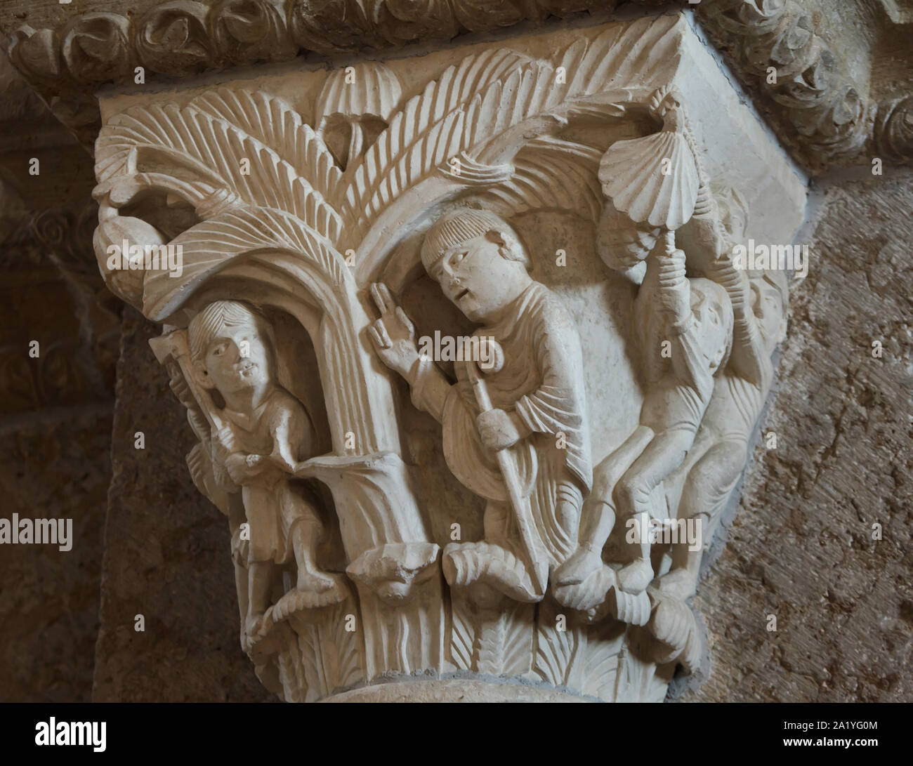 Saint Martin and the Tree depicted in the Romanesque capital dated from the 12th century in the Basilica of Saint Mary Magdalene (Basilique Sainte-Marie-Madeleine de Vézelay) of the Vézelay Abbey (Abbaye Sainte-Marie-Madeleine de Vézelay) in Vézelay, Burgundy, France. Stock Photo