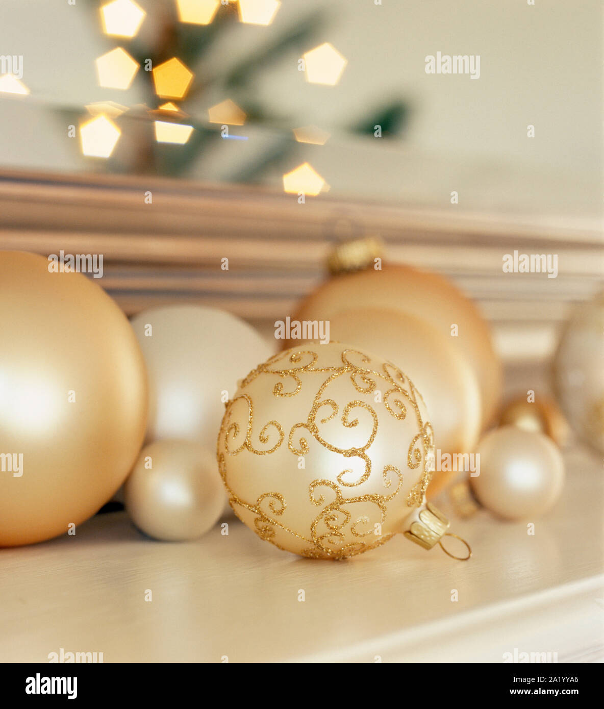 Silver And Gold Baubles Ornaments On Living Room Mantel With Reflection Of Lighted Christmas Tree In Background Elegant Holiday Home Interior Decor Stock Photo Alamy