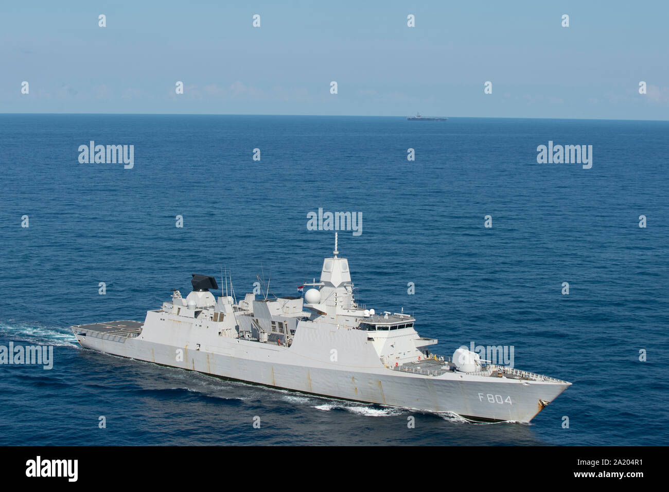 190928-N-QD512-1282  ATLANTIC OCEAN (Sept. 28, 2019) The Royal Netherlands Navy De Seven Provinciën-class frigate HNLMS De Ruyter (F804) transits the Atlantic Ocean during a photo exercise with the aircraft carrier USS Dwight D. Eisenhower to conclude Tailored Ship's Training Availability (TSTA) and Final Evaluation Problem (FEP) as part of the basic phase of the Optimized Fleet Response Plan. (U.S. Navy photo by Mass Communication Specialist 3rd Class Kaleb J. Sarten) Stock Photo