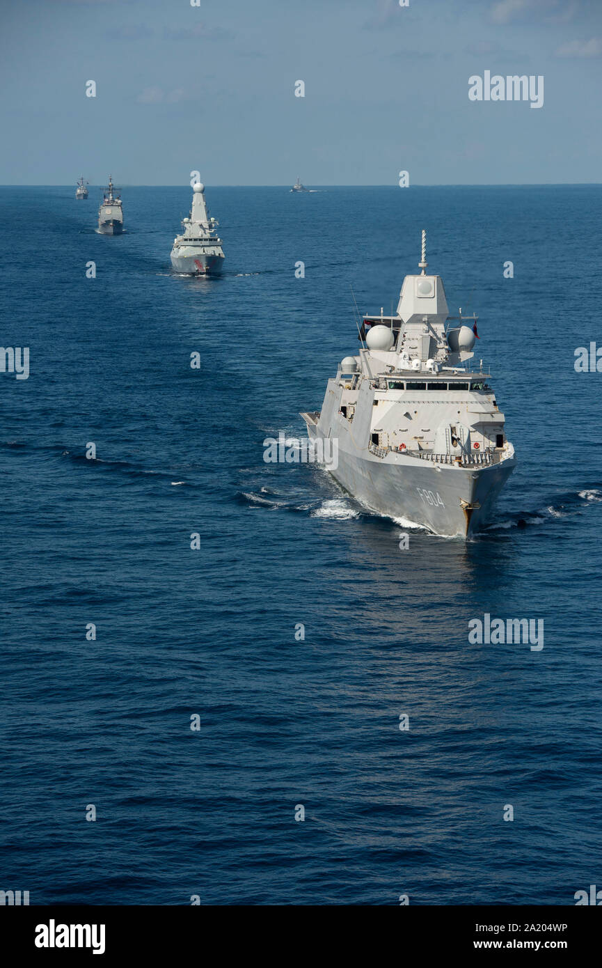 190928-N-YZ751-1368  ATLANTIC OCEAN (Sept. 28, 2019) Royal Netherlands Navy De Seven Provinciën-class frigate HNLMS De Ruyter (F804) and Royal Navy Daring-class air-defense destroyer HMS Dragon transit the Atlantic Ocean with ships assigned to Carrier Strike Group (CSG) 10 and aircraft assigned to Carrier Air Wing (CVW) 3 during a photo exercise to conclude Tailored Ship's Training Availability (TSTA) and Final Evaluation Problem (FEP) as part of the basic phase of the Optimized Fleet Response Plan. (U.S. Navy photo by Mass Communication Specialist 1st Class Tony D. Curtis) Stock Photo