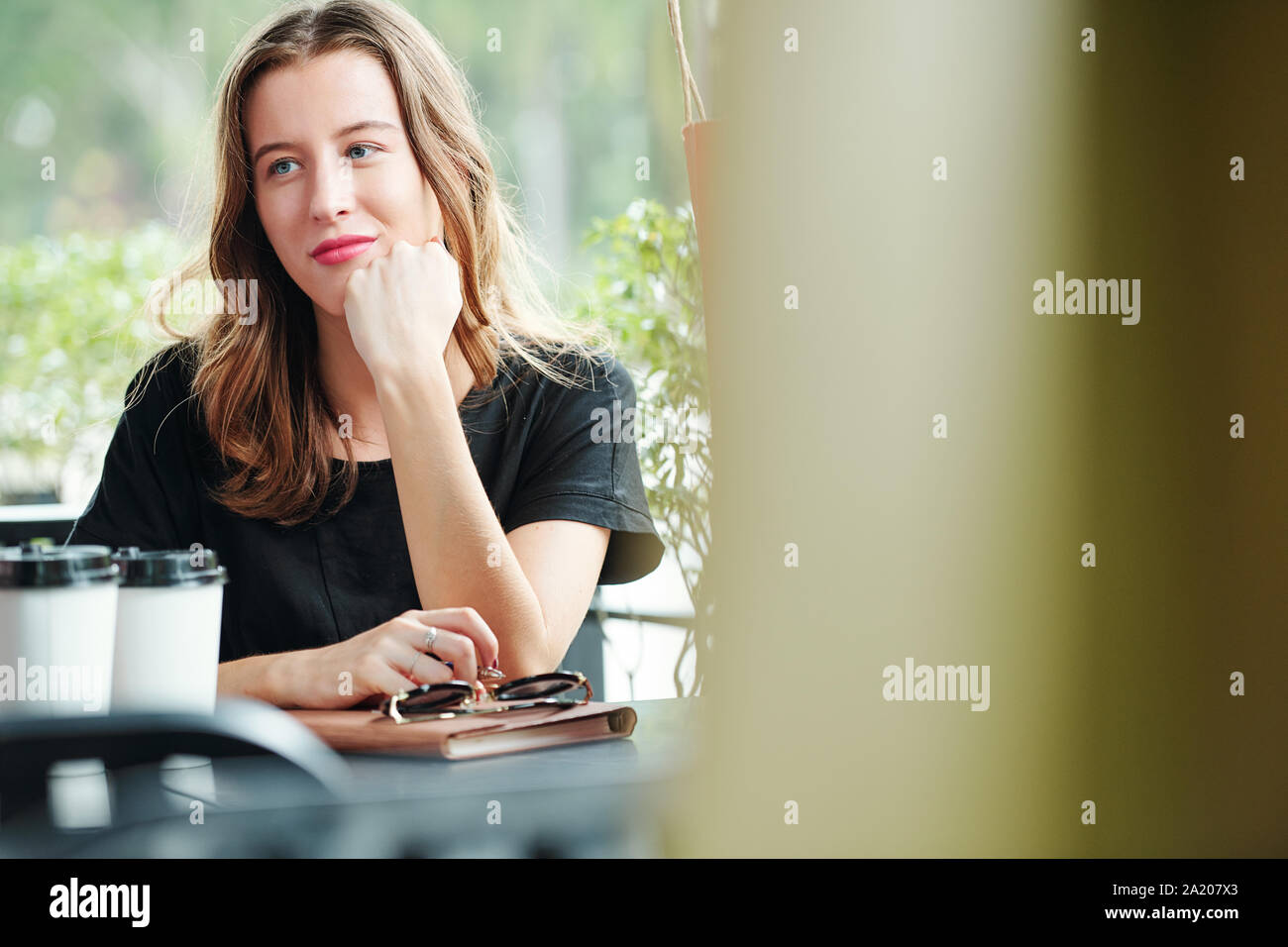 Portrait Of Beautiful Pensive Young Caucasian Woman Sitting At Table In Outdoor Cafe And Pondering Over Creative Ideas Stock Photo Alamy