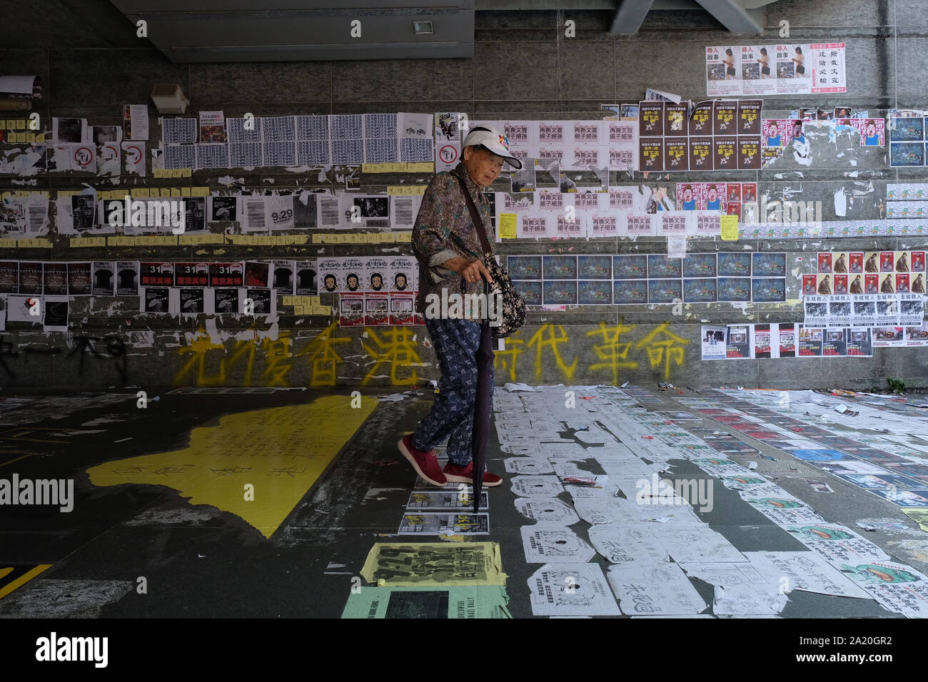 Posters and messages covering the walls and pavements in Kowloon, Hong Kong, where authorities have rejected an appeal for a major pro-democracy march on China's National Day holiday, following two straight days of violent clashes between protesters and police. Stock Photo