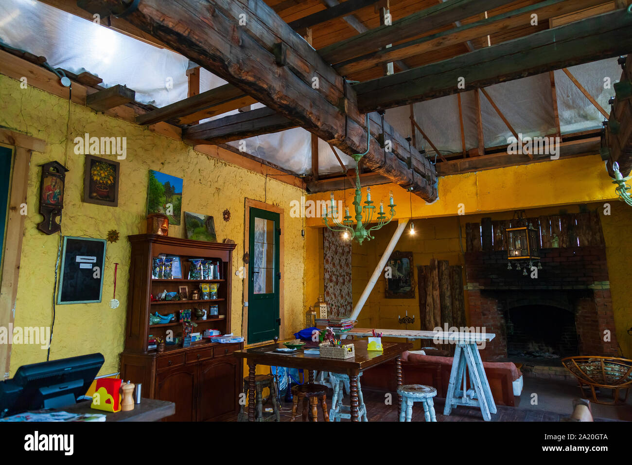 Cafe Or Restaurant Interior In Retro Vintage Style With Colored Old Things Wooden Table And Chairs And Roof Interior Design Stock Photo Alamy