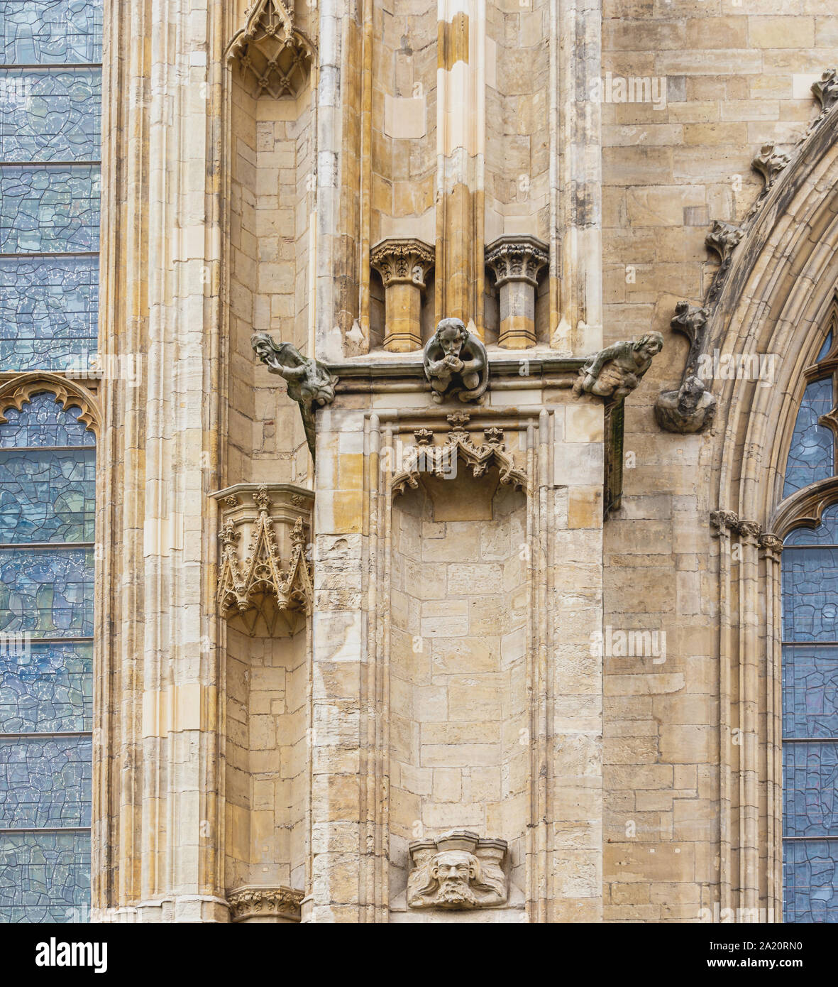 Gargoyles on the east end of York Minster.  The column sits beside the famous stained-glass Great East Window. Stock Photo