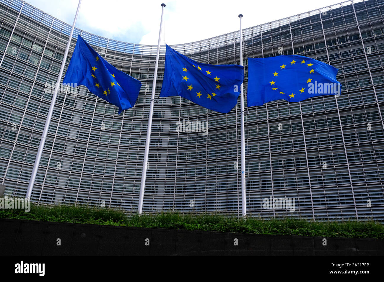 Brussels, Belgium. 30th Oct. 2019.  The European Union flags fly at half-mast as a tribute to former French President Jacques Chirac in front of the European Commission building. Stock Photo