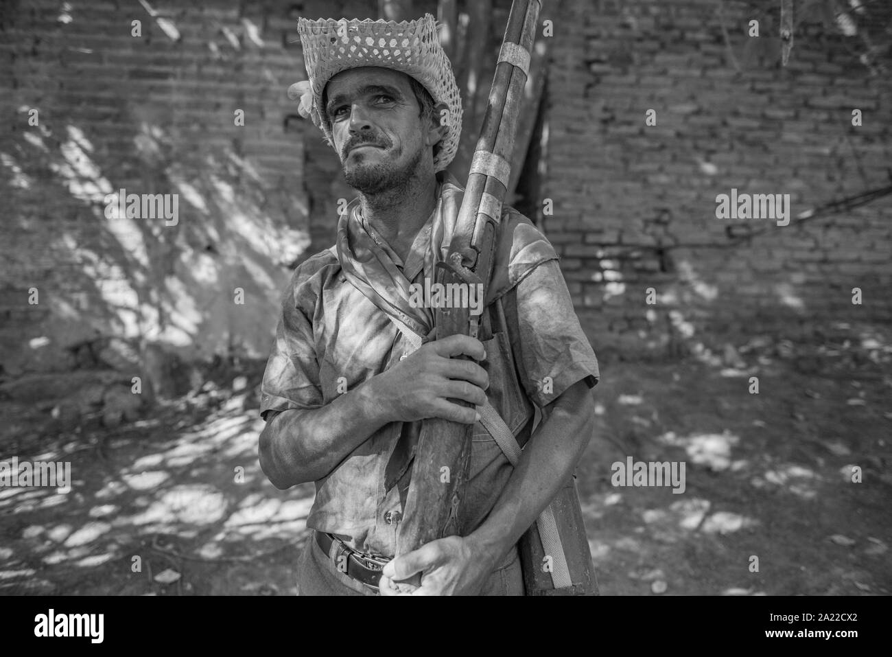 Man wearing costume of gunman during June festival in northeast Brazil Stock Photo