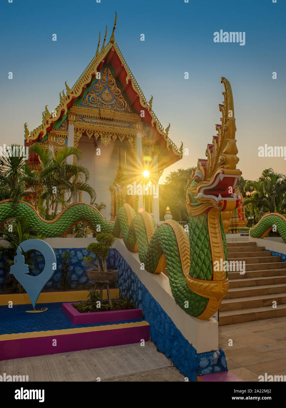 Wat Karon buddhist temple in Phuket island, Thailand. Amazing morning lights and brigt sun in this colorful picture. Stock Photo