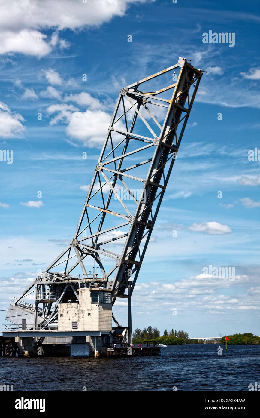 small lift bridge, open position, allowing boat traffic through, Intracoastal Waterway, southwest Florida, FL; spring; vertical Stock Photo