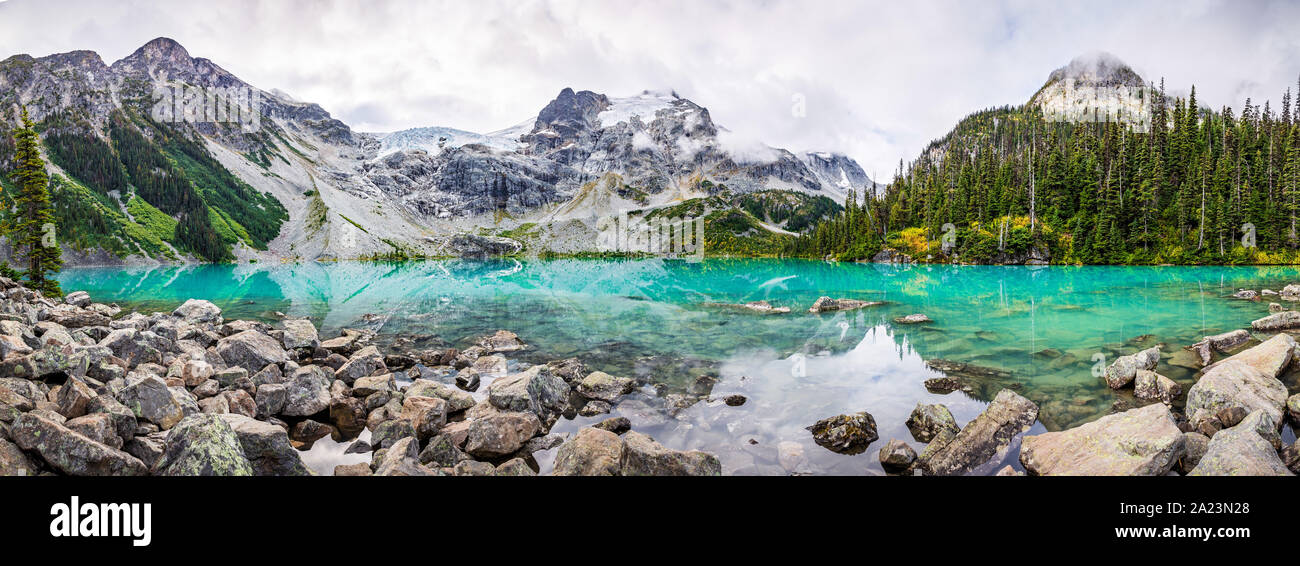 Daytime Mountain Panorama with Beautiful Turquoise Glacier Fed lake. Joffre Lakes Provincial Park, British Columbia, Canada Stock Photo