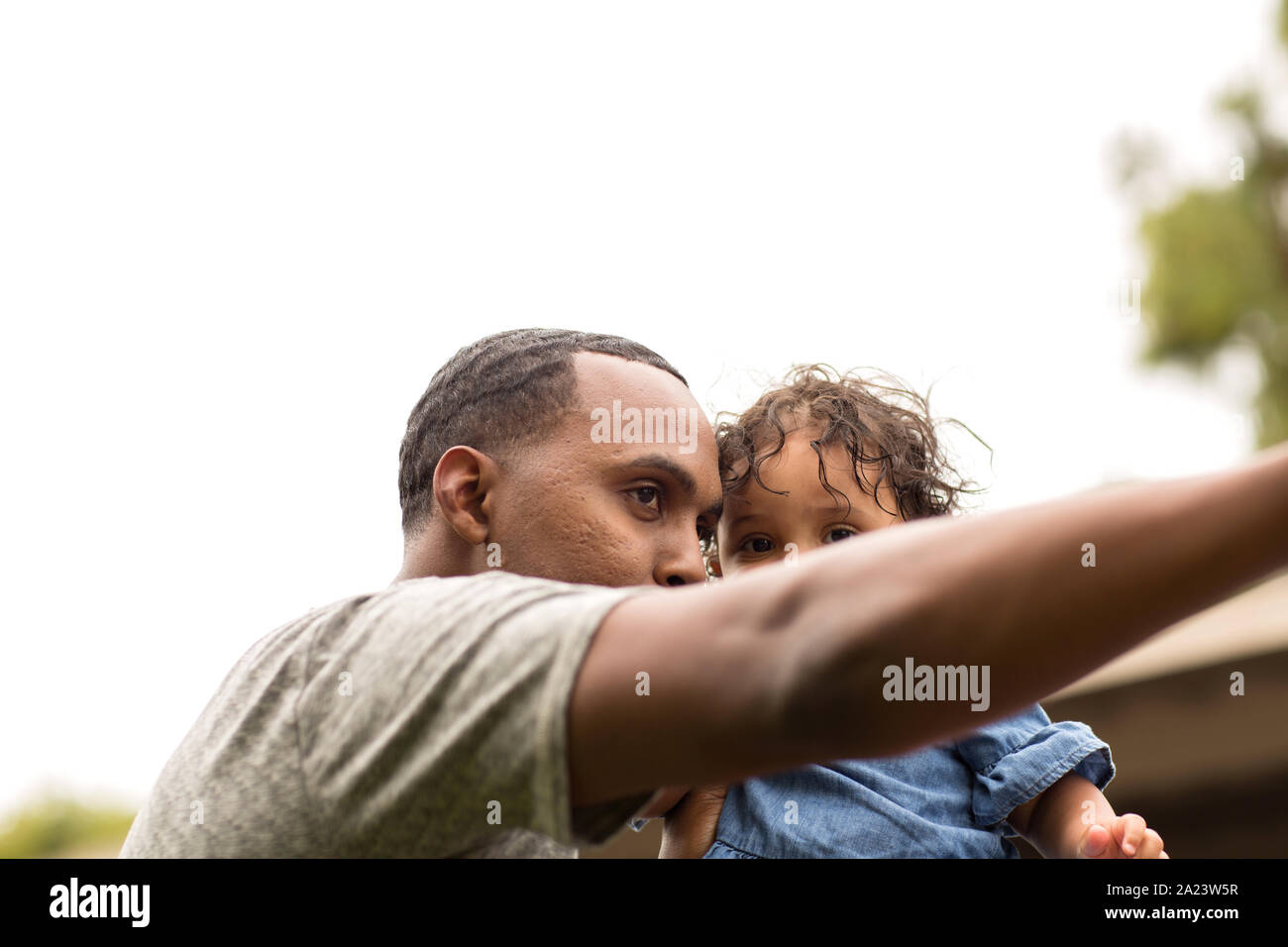 Father holding his little girl. Mixed race family. Stock Photo