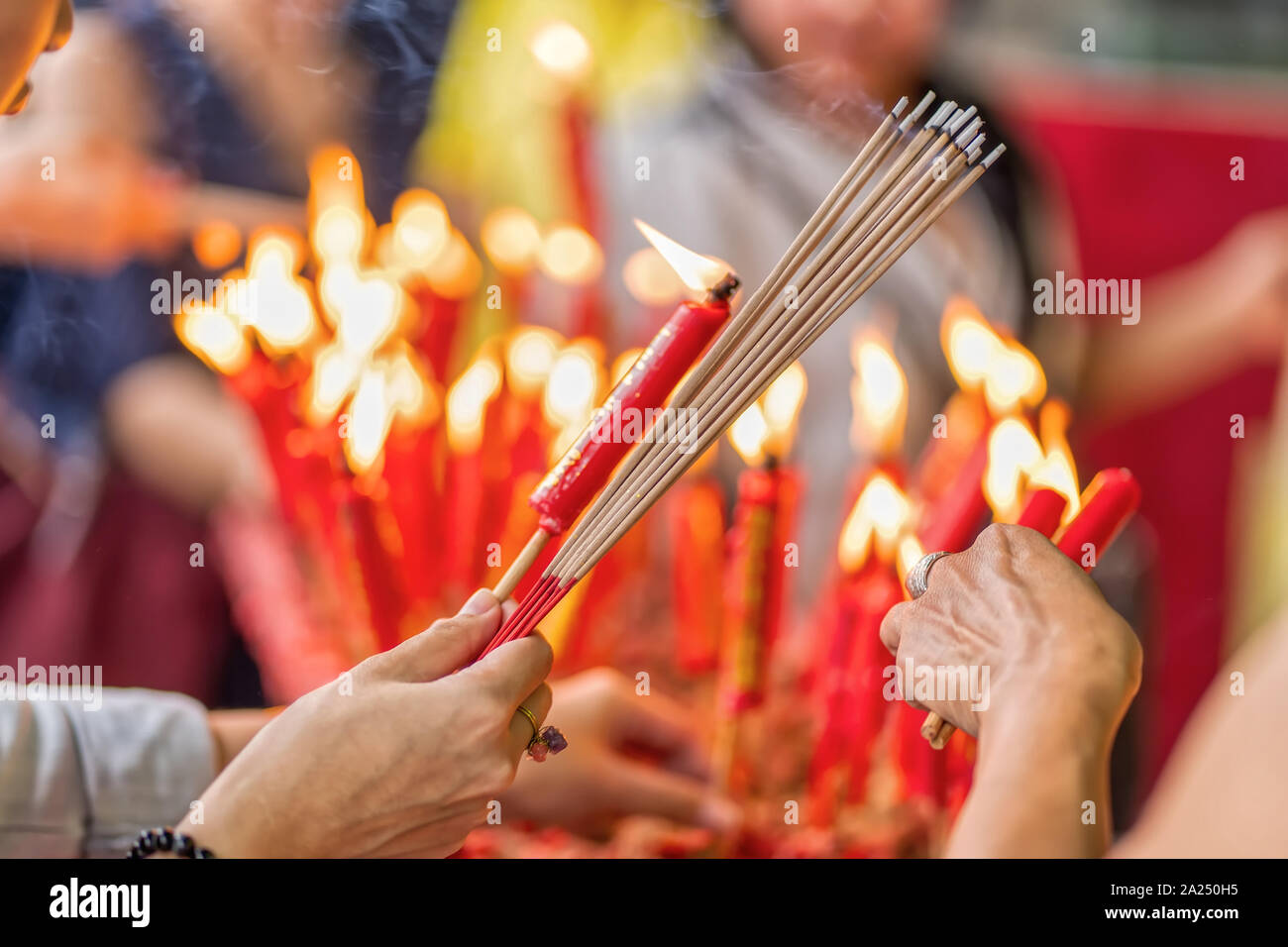 The Burning Incense And Candle Worship In Buddhism Stock Photo Alamy