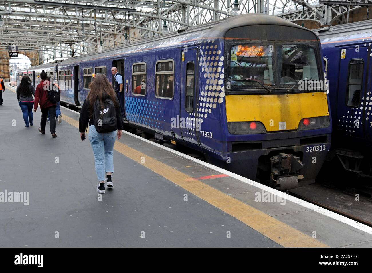 Passengers boarding Scotrail Class 320 electric trains at Glasgow Central Station Stock Photo
