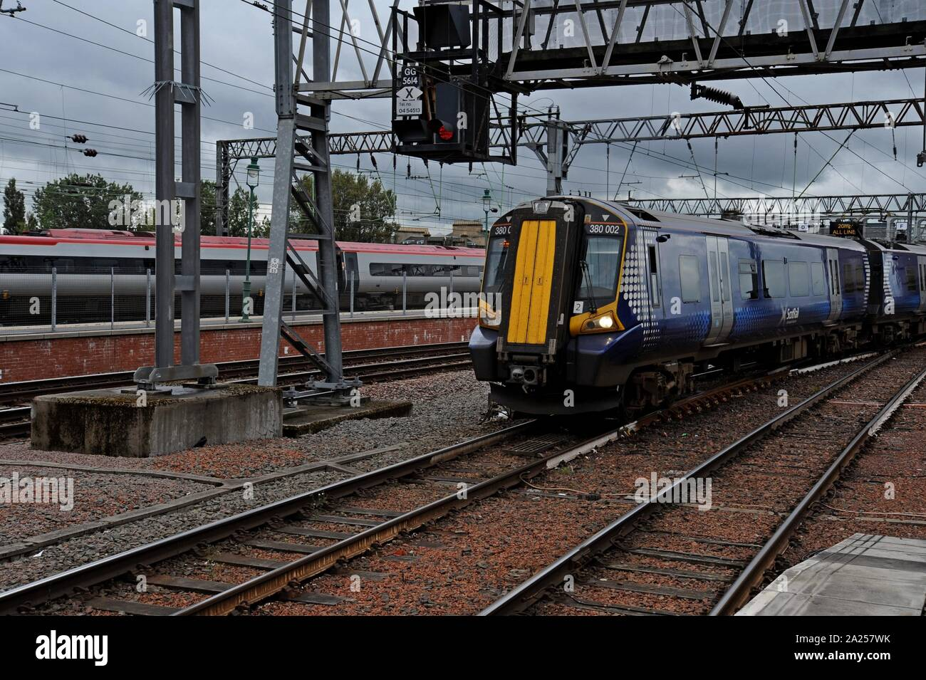 Scotrail Class 380 Desiro electric trains leaving Glasgow Central Station Stock Photo