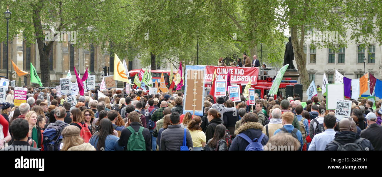 Large crowds filled Parliament Square calling for a climate emergency to be declared. It was the culmination of weeks of demonstrations and protests which have shut down streets in inner London and other cities, causing massive traffic disruption. The protest was called by YouthStrike4Climate, Momentum, Extinction Rebellion and 14 other groups may 2nd 2019 Stock Photo