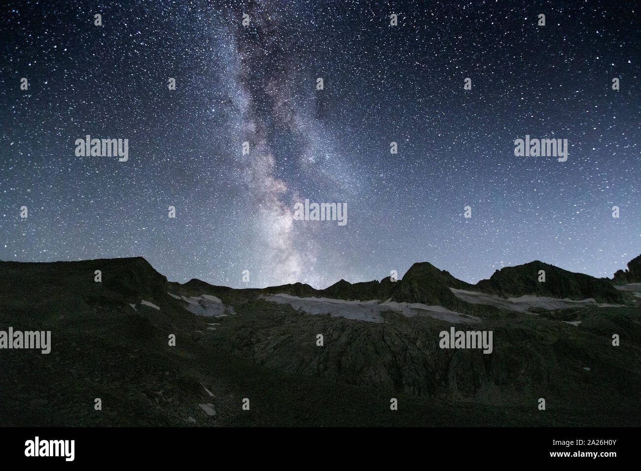 Milky Way and starry sky. Night landscape. Rainbachtal valley. Rainbach-Schwarzkopf peaks.  Zillertaler Alps. Hohe Tauern National Park. Austrian Alps. Stock Photo