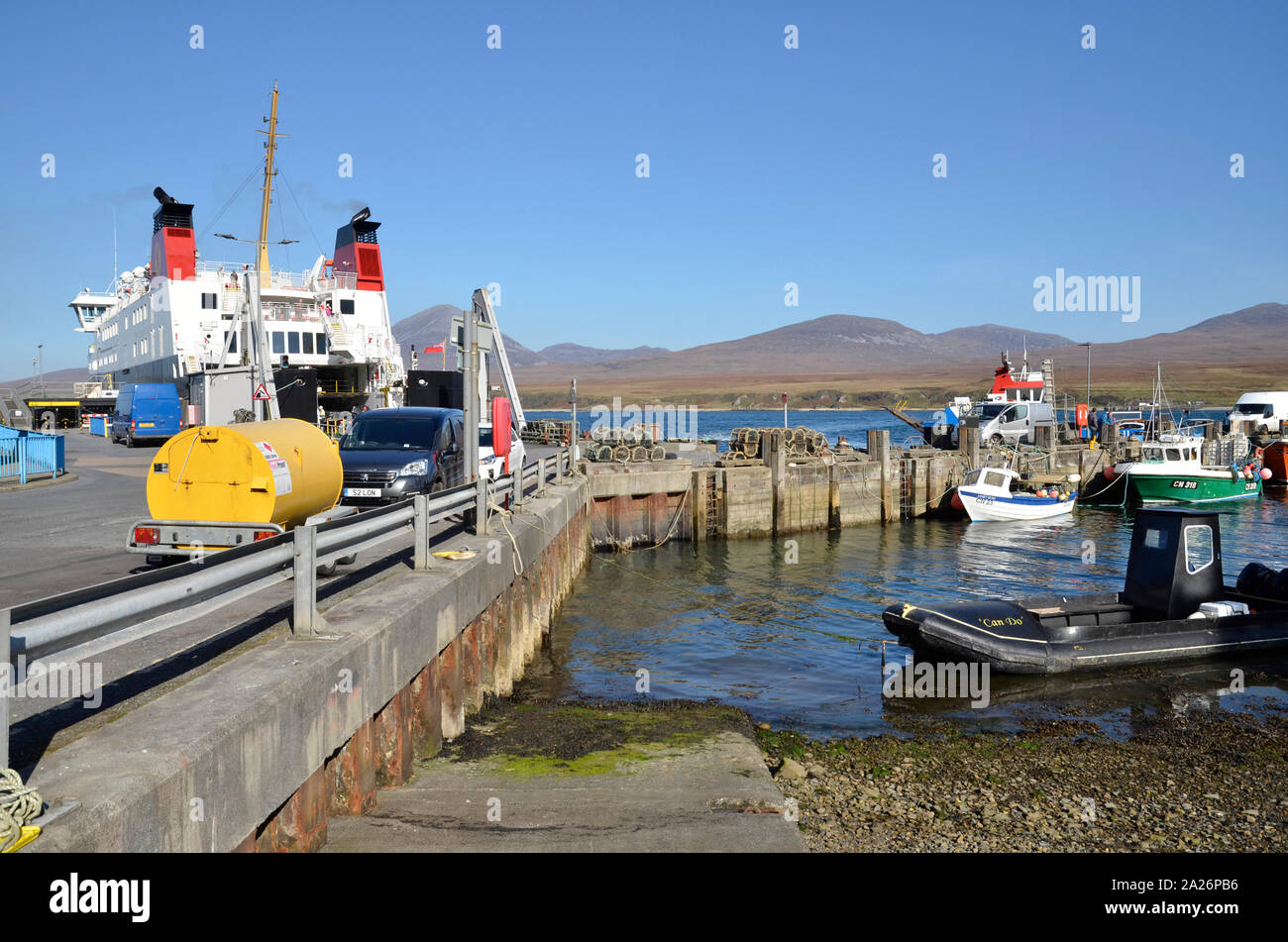 MV Finlaggan, a Caledonian MacBrayne island ferry at Port Askaig on the Scottish Island of Islay. The hills of Jura can be seen in the background. Stock Photo